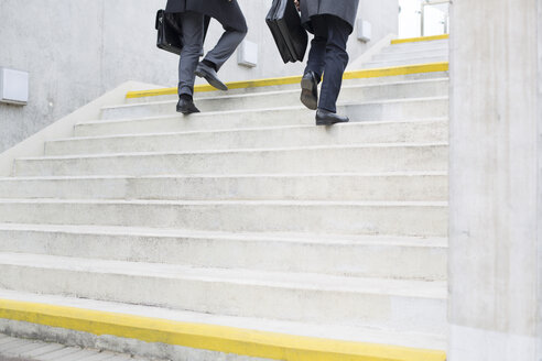 Two businessmen walking on stairs - WESTF021291