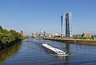 Germany, Frankfurt, view to cargo ship on Main River with European Central Bank in the background - SIEF006638