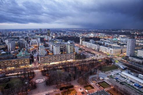 Poland, Warsaw, view to the city centre at evening twilight - ABOF000028
