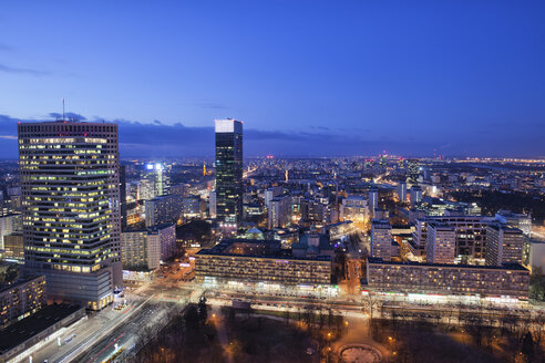 Poland, Warsaw, view to the city centre at evening twilight - ABOF000031