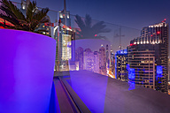 UAE, Dubai, lighted skyscrapers of Dubai Marina seen from a roof terrace - NKF000294