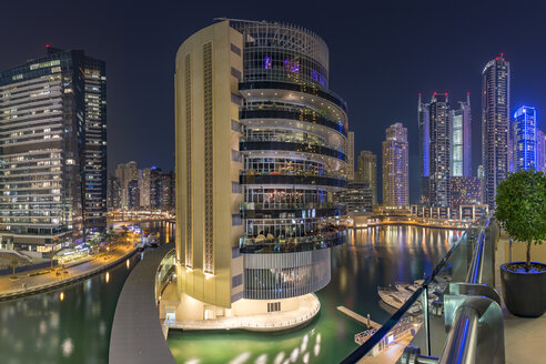 UAE, Dubai, view to the Pier 7 Building at Dubai Marina by night - NKF000297