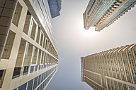 UAE, Dubai, view to facades of high-rise residential building from below - NKF000299