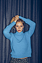 Portrait of young woman wearing light blue knit pullover - CHAF000538