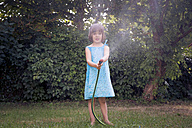 Little girl with garden hose - LVF003678