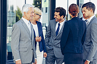 Group of confident business people talking - CHAF000381