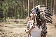 Young woman masquerade as an Indian in the woods - ASCF000202