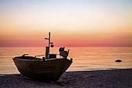 Germany, Ruegen, Binz, boat on beach at sunrise - PUF000383