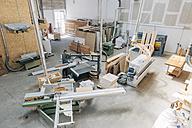Carpenter working on shop floor - JUBF000047