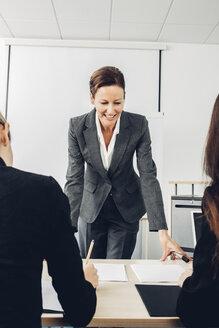Mature woman giving business presentation - CHAF000472