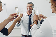 Group of business people raising a toast with champagne at office - CHAF001326