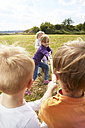 Children playing on a meadow - STKF001339