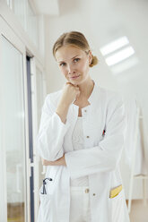 Portrait of female doctor with hand on chin - MFF001832