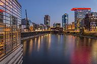 Germany, Duesseldorf, Media harbour at Lido Restaurant, blue hour - FR000278