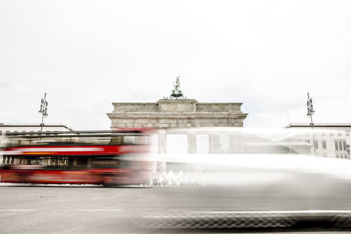 Germany, Berlin, view to Brandenburger Tor with driving red double-decker bus in the foreground - CHPF000154