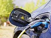 Reloading of an electric car, close-up - LAF001432