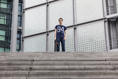 Germany, Berlin, teenage boy with  skateboard - MMFF000877