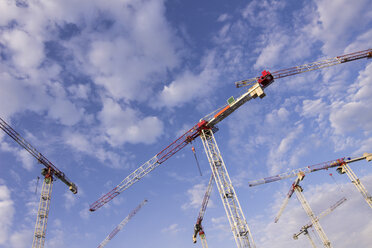 Germany, Berlin, cranes at construction site - CMF000285