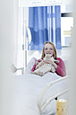 Portrait of smiling girl lying in hospital bed - ZEF006017