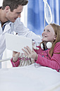 Doctor and girl with digital tablet in a hospital room - ZEF006021