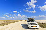 Namibia, Etosha National Park, off-road vehicle with roof tent parking at Fisher's Pan - FOF008107