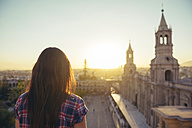 Peru, Arequipa, woman looking at Plaza de Armas enjoying sunset - GEMF000286