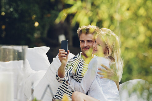Young man taking a selfie of himself and his girlfriend - CHAF000955