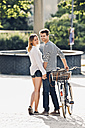 Young couple holding hands on the street - CHAF000819