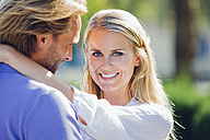 Portrait of smiling couple outdoors - CHAF000644