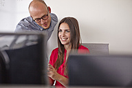 Confident man and woman in office - RHF000910