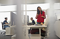 Colleagues working in open-plan office - RHF000951