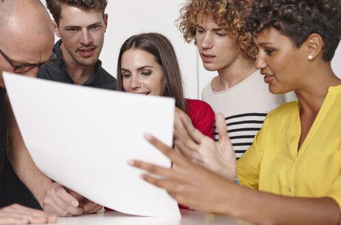Five colleagues having an informal meeting in office - RHF000969