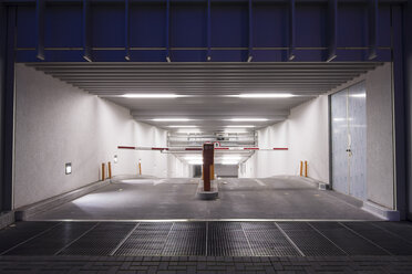 Germany, Berlin, entrance to underground car park at night - CM000295