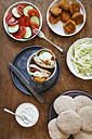 Preparation of falafel with cabbage salad in wholemeal spelt pita bread - EVGF001941