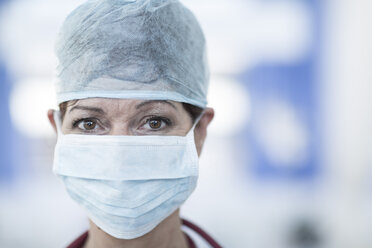 Portrait of doctor in hospital wearing surgical mask - ZEF006116