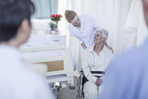 Nurse with elderly female patient in wheelchair - ZEF006807