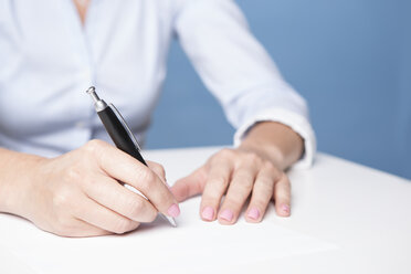 Woman signing document on the table - VTF000432