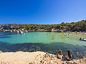 Spain, Balearic Islands, Mallorca, Two female tourists looking to bay of Portals Vells - AM004103