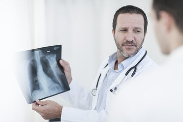 Doctors with x-ray image in a hospital - ZEF006244