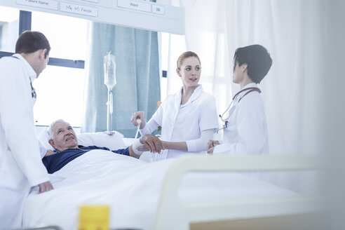 Two doctors, nurse and a patient in a hospital room - ZEF006260