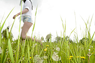 Young woman running on a meadow - BFRF001369