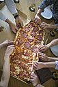 Colleagues in office sharing pizza - FKF001219
