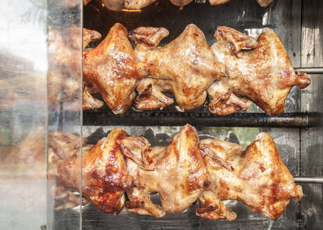 Chickens roasting on a grill - DEGF000468