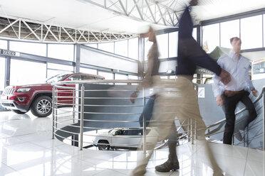 People walking in car dealership - ZEF006889