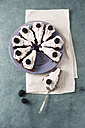 Sliced chocolate cake with creme and blackberries - MYF001096