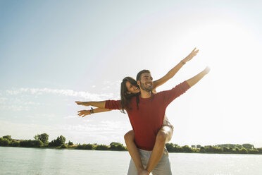 Carefree young couple by the river - UUF005042