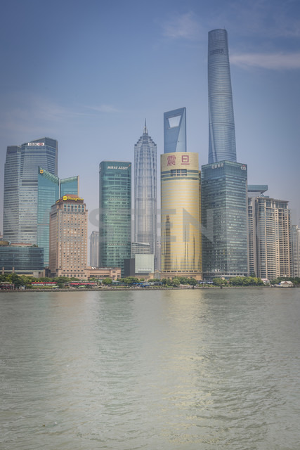 China, Shanghai, Jinmao Building, World Financial Center and Shanghai Tower peaking out of the Pudong Skyline - NKF000319