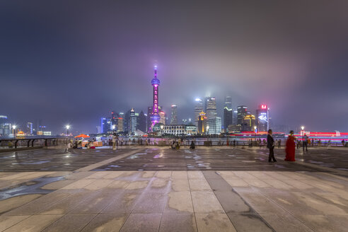China, Shanghai, Skyline of Pudong with Bund Promenade at night - NKF000324