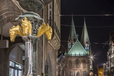 Germany, Bremen, fountain in the pedestrian area at night - NKF000333