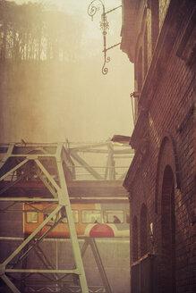 Germany, North Rhine-Westphalia, Wuppertal, Overhead railway in fog - DWI000546